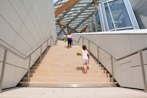 Kids make their own promenade in the Frank Gehry's building