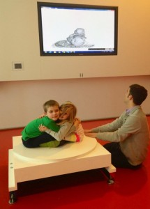 Figure 1: young visitors at the Art Institute pose like a statue to be modeled in 3D using a Microsoft Kinect and ReconstructMe.
