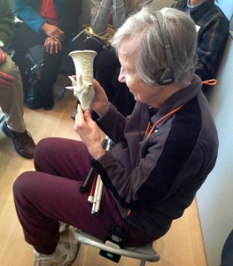 Figure 2: a visitor with sight impairment 'sees' the collection object by touching a 3D-printed replica.