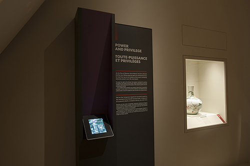 A picture of a museum exhibition panel with an iPad below