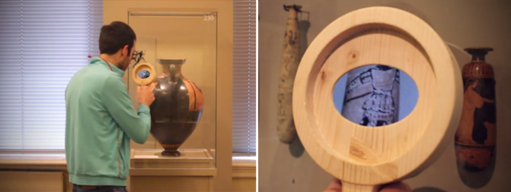 Figure 2: Unveiling hidden stories of objects at the Allard Pierson Museum. (Amsterdam) in a non-intrusive way. The visitor is not aware he is using the optical zoom of a smart-phone encased within the wooden magnifying glass.